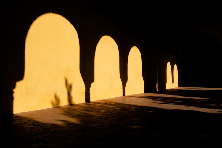Córdoba Cordoba Spain Mezquita Mezquita De Córdoba Light And Shadow Shadow And Light Arches Mosque Mosques Of The World Minimalist Architecture The Week on EyeEm Architecture Arch Built Structure Illuminated No People History Yellow The Past Indoors  Building Shadow Silhouette Travel Destinations Text Architectural Column