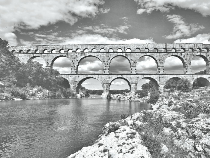Pont du Gard Arles Built Structure Bridge Water Architecture Cloud - Sky Connection Bridge - Man Made Structure Arch Sky Nature Transportation River Arch Bridge No People Day Plant Tree Outdoors Arched Pont Du Gard Pont Du Gard Arles Arles Arles Pont Du Gard Arles France Vers-Pont-du-Gard Vers Pont Du Gard France France Photos France Trip France Photography Holiday Destination Holiday Destinations Tourism Tourist Tourist Attraction  Tourist Destination Tourists Vacations Vacation Destination Vacation Photos   Europe European  European Architecture Europe Trip Aqueduct Pont DuGard Aqueduct Pont DuGard Aquaduct