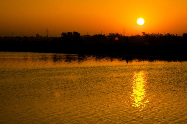 Sunrise Sunset Orange Color Reflection Nature Sky Scenics Silhouette Tree Water Beauty In Nature Lake Tranquility Outdoors Sun Tranquil Scene No People NikonAsia NIKON D5300 Nikonindia Nikonphotography Amateurphotographer  Vadodara Lake View Amateurphotography Eyeemphotography EyeEmNewHere