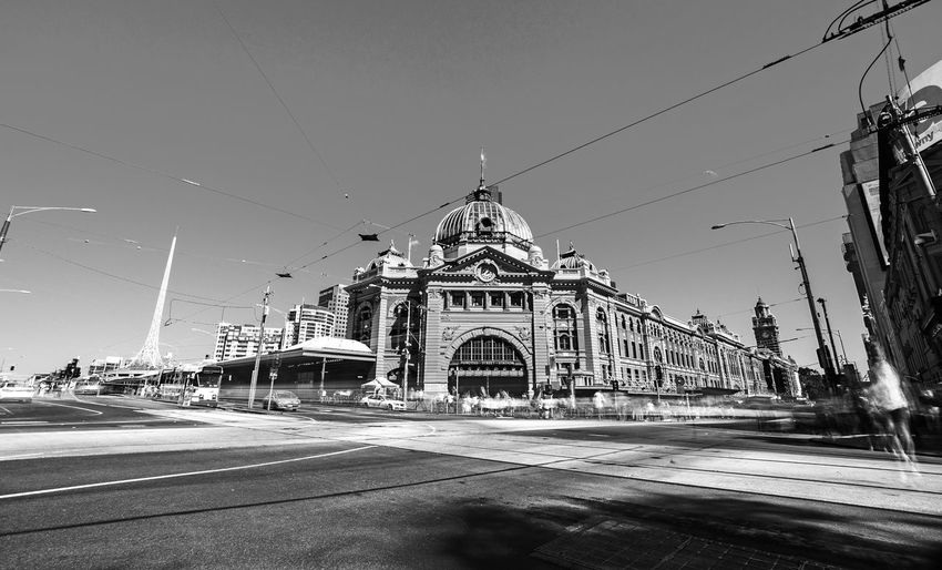 Just another day at the Flinders Street Station Australia Architecture Blackandwhite Building Exterior Built Structure Day Dome Flinders Street Station Long Exposure Melbourne Monochrome Outdoors Road Sky Travel Destinations EyeEmNewHere