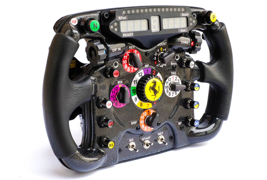 Formula One Steering Wheel Replica Product Photography Formula One Racing Steering Wheel Motorsport Technology Product Photography Knobs And Dials White Background