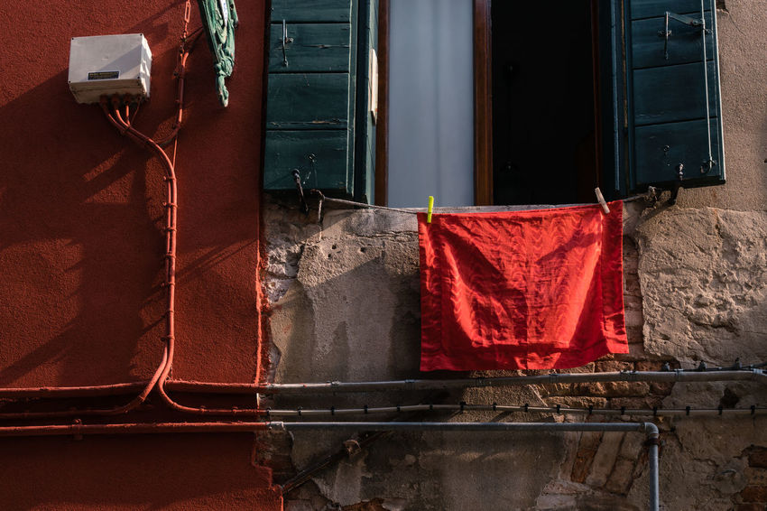 Architecture Burano, Venice Colors Italia Light Shadow And Light Travel Travel Photography Venezia Venezia, Italia Venice, Italy Burano Color Colorful Day Drying Hanging Italy No People Outdoors Photography Red Streetscape Venice Window