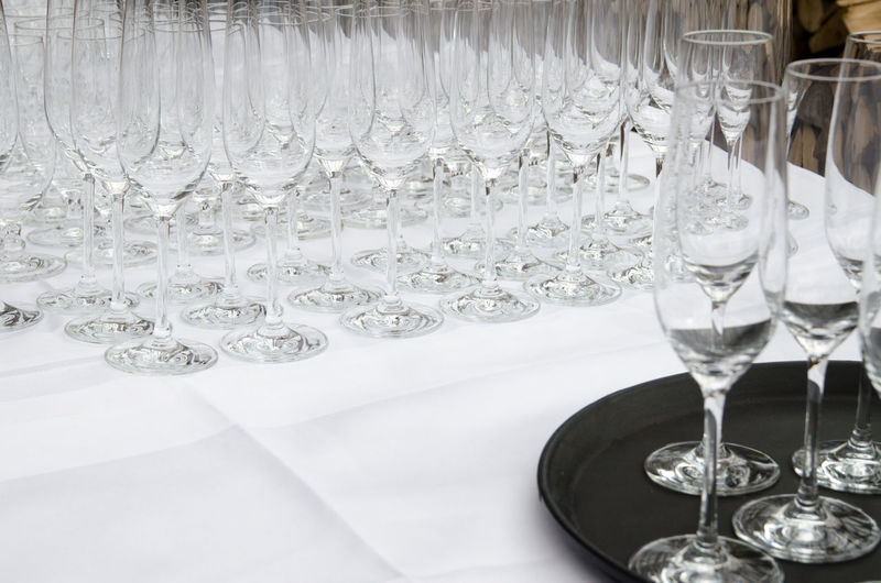 Champagne Flutes Arranged On Table