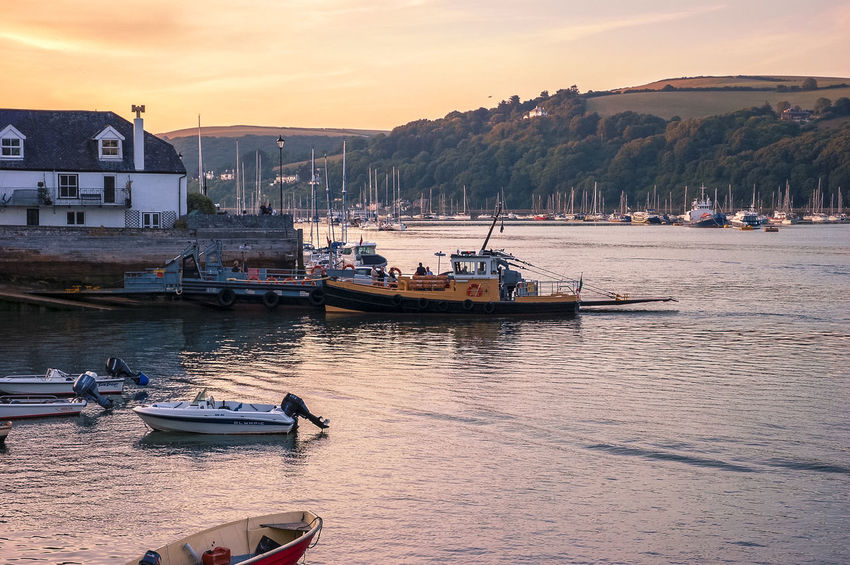 A view of Dartmouth in South Devon at sunset. Beautiful Boat Boats Dartmouth Devon Estuary Ferry Holiday Holidays Kingswear Lower Ferry Picturesque River River Dart Riverscape Scenic South Devon Sunset Tranquil Scene Tug Vacation