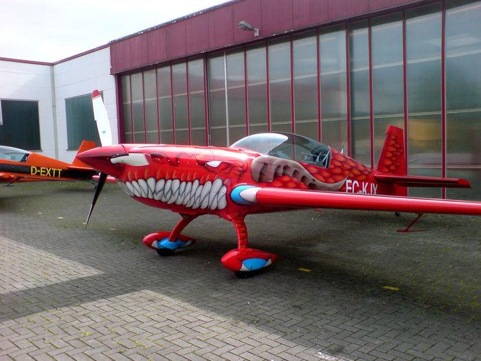 Extra Extra 300 Kunstflug Kunstflugzeug Air Vehicle Airplane Airport Architecture Day Mode Of Transportation No People Outdoors Red Transportation Travel