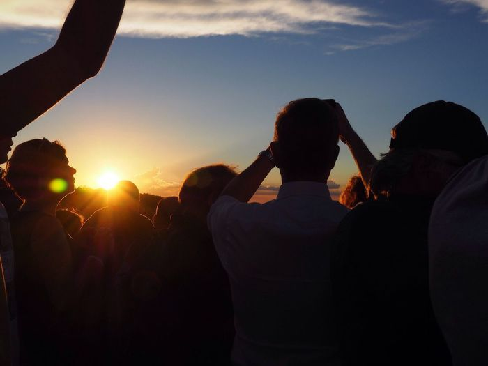 Rear View Of People Against Sky During Sunset
