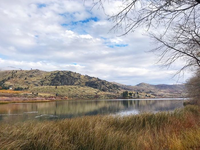 One of the Four Lakes above Lake Chelan on a fall day Mountain Scenics Lake Nature Beauty In Nature Water Sky Tranquility No People Mountain Range Tranquil Scene Day Outdoors Landscape Cloud - Sky Tree Grass fall autumn Leaves Tree Beauty In Nature Travel Destinations
