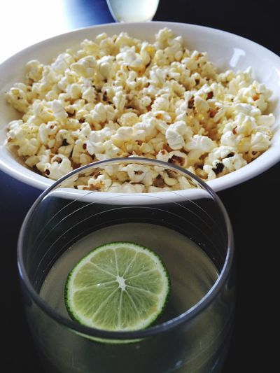 Close-Up Of Popcorn And Lemon Juice