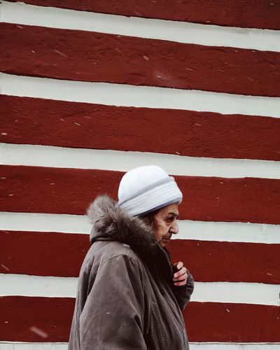 Woman near the church Winter Warm Clothing Cold Temperature One Woman Only Day Wall Striped Vscocam One Person Red