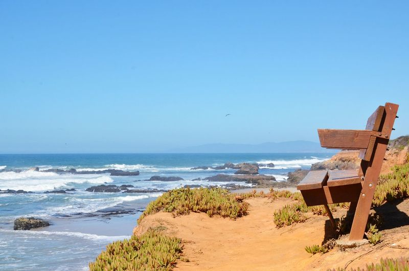 Your seat is available and ready for the taking. California calling. Sea Beach Horizon Over Water Wooden Structure On A Cliff Over The Ocean Copy Space Over Ocean Balanced View Edge Of The World Pacific Coast Clear Blue Sky And Sea EyeEm Nature Lover Beauty In Nature Architecture And Nature California Coast Beach Life Vacations Beauty In Nature Tranquility Coastline Blue No People Bench By The Sea Breathing Space