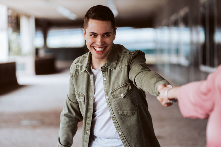 Portrait of smiling young man standing outdoors