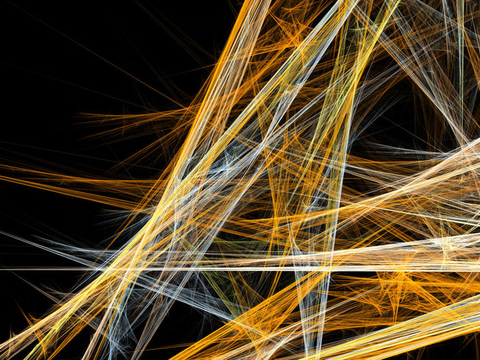 Abstract image of illuminated lights against black background