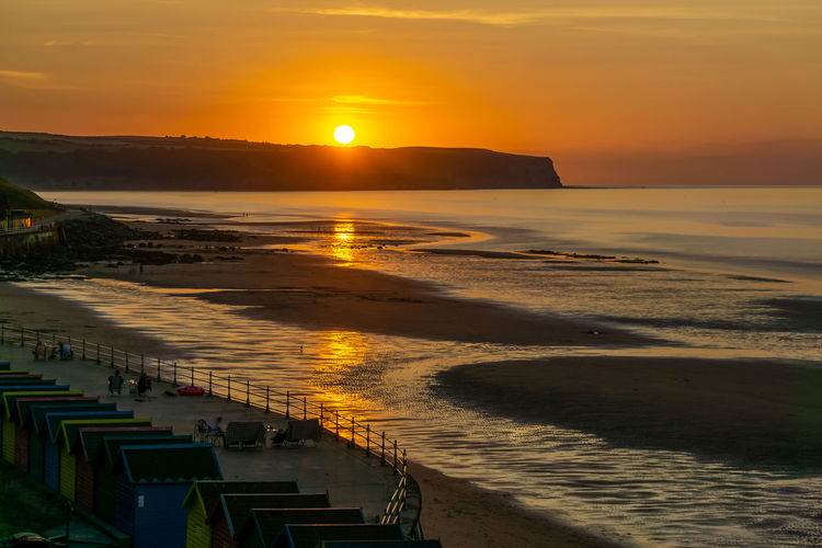Sunset over the coast at Whitby, North Yorkshire Coastline Coastline Landscape Beach Beachphotography Beauty In Nature Built Structure Cloud - Sky Coast Land Nature No People Orange Color Outdoors Scenics - Nature Sea Sky Sun Sunlight Sunset Tranquil Scene Water