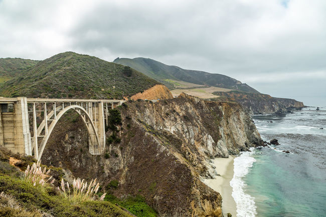 Arch Architecture Beauty In Nature Bixby Bridge Bixby Creek Bridge Bridge - Man Made Structure California Coast Cultures Day Landscape Mountain Mountain Range Nature No People Outdoors Pacific Pacific Coast Pacific Coast Highway Pacific Ocean Scenics Travel Destinations Tree Vacations