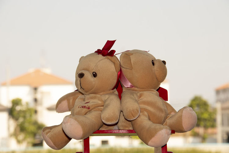 Close-up of stuffed toy against sky