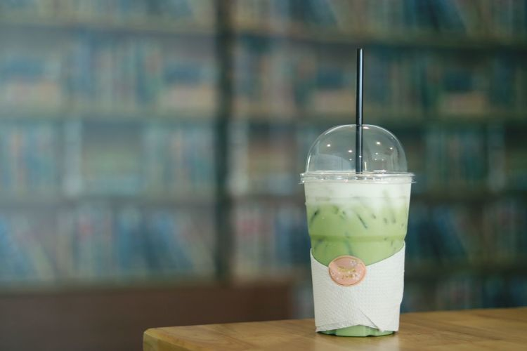 Close-up of smoothie in disposable cup on table