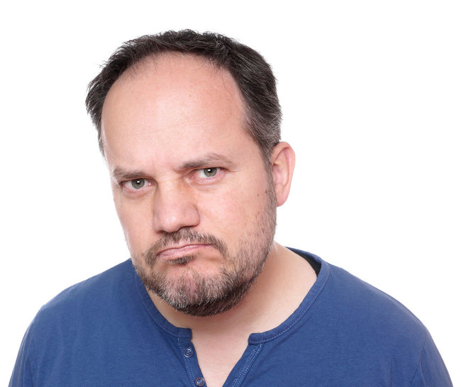 Displeased Man Unhappy Beard Black Hair Cut Out Greying Guy Headshot Making A Face Male Mid Adult Middle Aged One Person People person Portrait Real People Sceptical Short Hair Stubble Studio Shot White Background