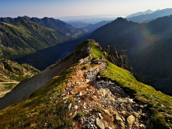 Mountain trail in the morning. mountain landscape with the rising sun.