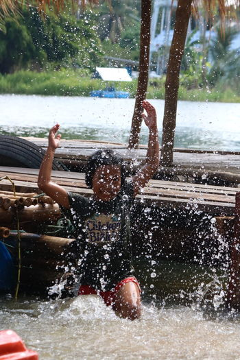 Man splashing water in park