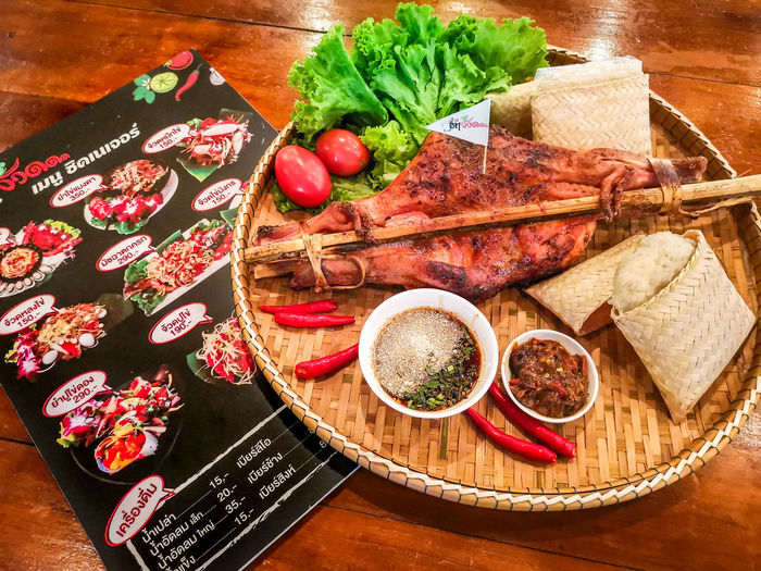 grilled Chicken with sticky rice thai food Grilled Chicken .Thailand Food Style Grilled Chicken Tray Table Plate High Angle View Leaf Preparation  Close-up Food And Drink