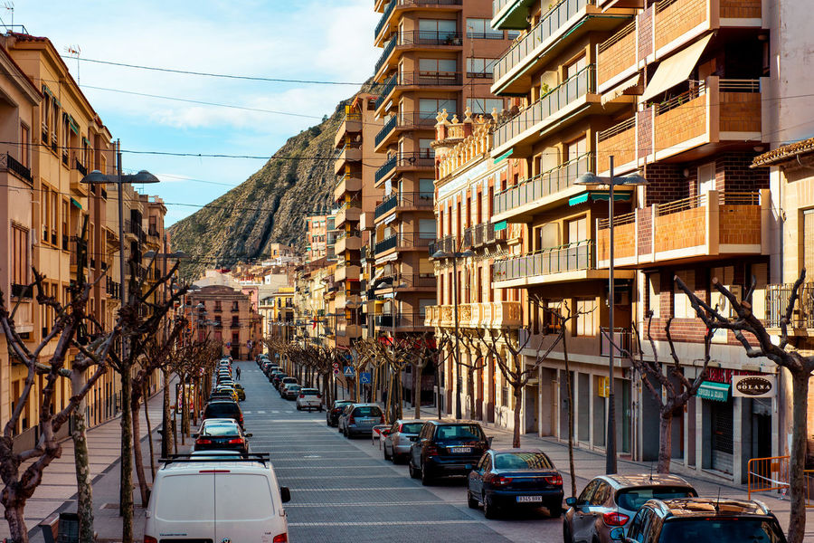 Central street of Jijona/Xixona town. Alicante province. Spain Alicante, Spain Architecture Automobile Cars City Costa Blanca Europe Jijona Mountain Outdoors Parked Cars Perspective Residential Building Road Roadside Siesta SPAIN Street Sunny Day Town Trees Typical Houses Urban Scene Village Xixona