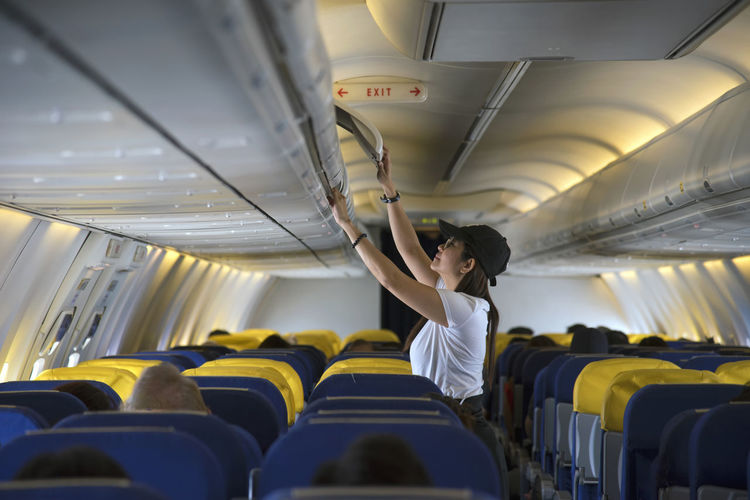 Woman standing in airplane