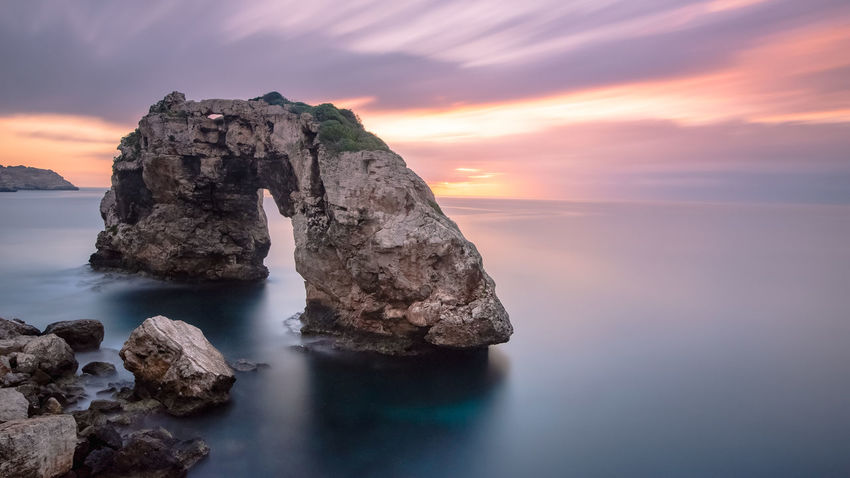 Es Pontàs EyeEm Best Shots Nature Beach Beauty In Nature Cloud - Sky Eroded Horizon Horizon Over Water Idyllic Natural Arch Nature No People Outdoors Rock - Object Rock Formation Scenics - Nature Sea Sky Solid Stack Rock Sunset Tranquil Scene Tranquility Water Waterfront