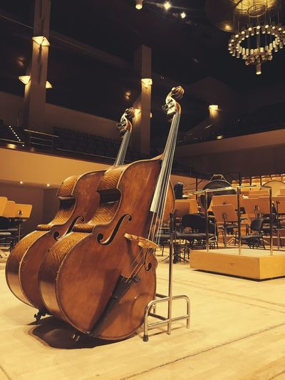 Music Musical Instrument Arts Culture And Entertainment Stage - Performance Space Indoors  Musical Instrument String Drum Kit Illuminated Drum - Percussion Instrument Concert Hall  No People Recording Studio Electric Guitar Rock Music Guitar Popular Music Concert Cello Violoncello