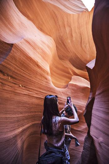 Women photographing at antelope canyon
