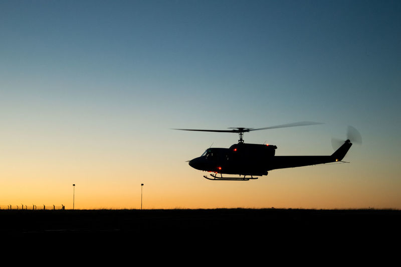 flying huey helicopter silhouette Military Military Life Night Sunrise Sun Chopper Rotor Blade Horizon Landscape Flight Pilot PilotsLife Copilot War Fly Rescue Dramatic Sky Uh1h Vietnam Helicopter Silhouette Sunset Flying Air Vehicle Transportation Technology Outdoors Sky Day