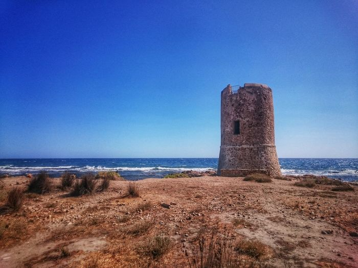 The Week On EyeEm Travel Photography Travel Destinations Travel Beach Sea Sand Water Blue Outdoors Horizon Over Water Sky No People Nature Day Sardegna Sardinia,italy Tower