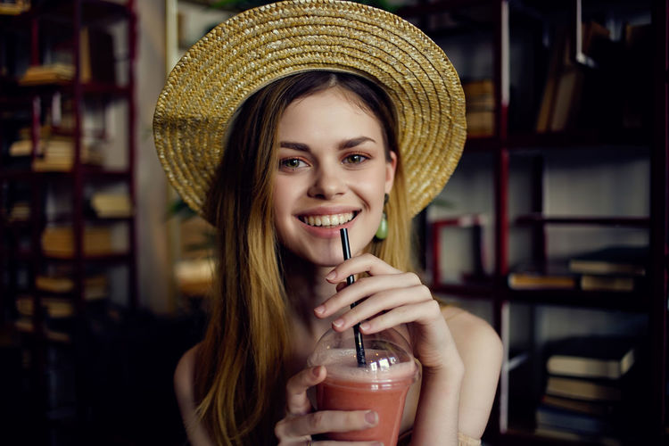 Portrait of smiling young woman in restaurant
