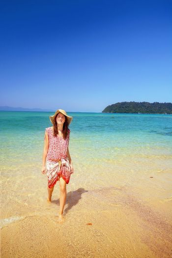 Summer girl Woman Young BeachCopy Space Tropical Sea Walking Happy Thailand Buffalo Bay Clear Sky Blue Vacation Sunny Dress Hippie Hippiegirl Looking At Camera Andaman Sea Andaman Summer Water Uniqueness Women Around The World Sommergefühle