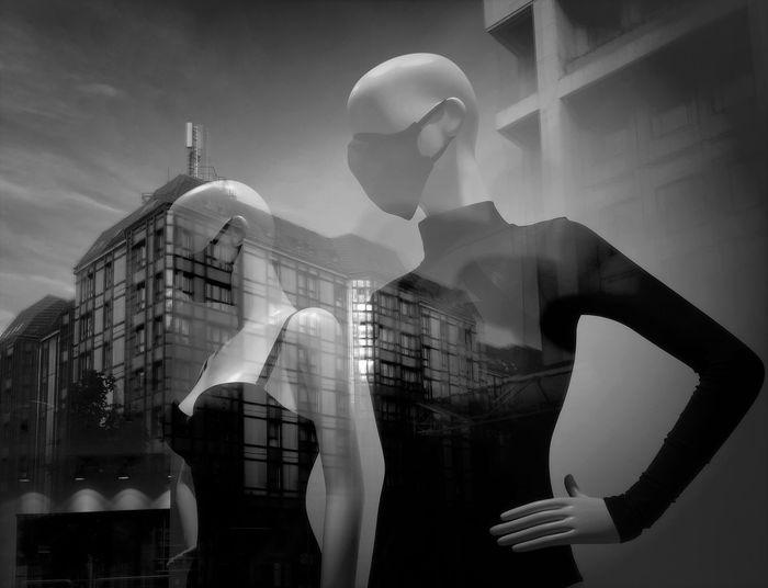 Digital composite image of people in glass window
