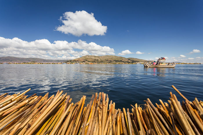 Titicaca Totora Uros Uros Island Beauty In Nature Cloud - Sky Day Indigenous  Kayak Lake Men Mountain Nature Nautical Vessel Oar Outdoors People Real People Rowing Scenics Sitting Sky Southamerica Tranquility Vacations Water