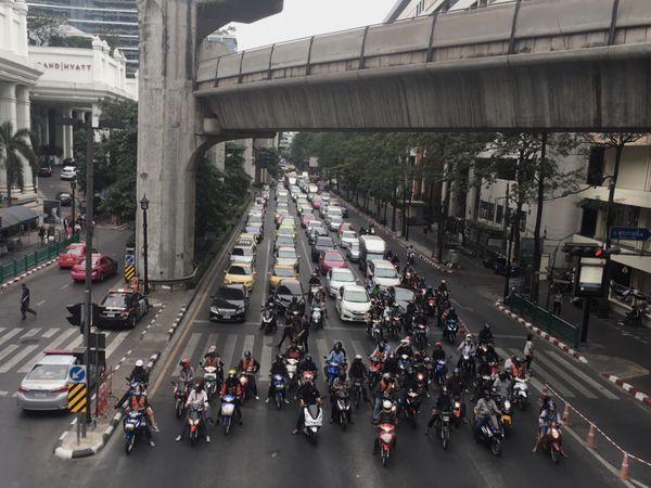 Transportation Large Group Of People Architecture Road Street City Land Vehicle Built Structure Mode Of Transport Road Marking Bridge - Man Made Structure Car Building Exterior High Angle View City Street Real People Walking City Life Day Men Bike
