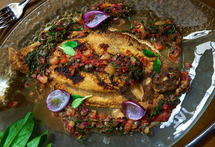 Baked whole flounder fish served with sauce Baked Cooked Cooked Food Cuisine Dieting Fish Flounder Food Food And Drink Gourmet Healthy Eating Main Course No People Plaice Plate Portion Prepared Fish Prepared Food Ready-to-eat Restaurant Sauce Seafood Served Serving Dish Whole Fish