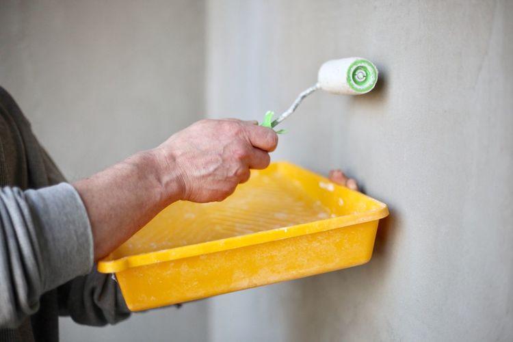 Cropped image of man preparing food against wall