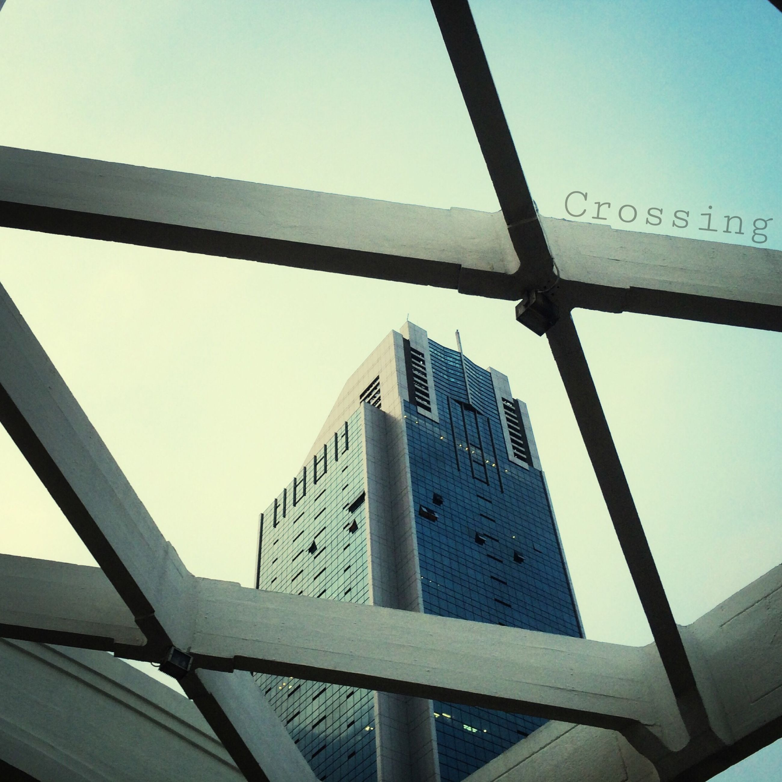 architecture, built structure, low angle view, building exterior, clear sky, city, skyscraper, tall - high, tower, modern, sky, connection, office building, bridge - man made structure, glass - material, engineering, capital cities, development, travel destinations, day