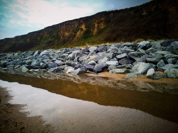 Beach Photography Beauty In Nature Cliff Coastal Defences Day Environment Flowing Water Landscape Nature No People Outdoors Reflection Rock Rock - Object Scenics - Nature Sky Solid Tranquil Scene Tranquility Water Waterfront
