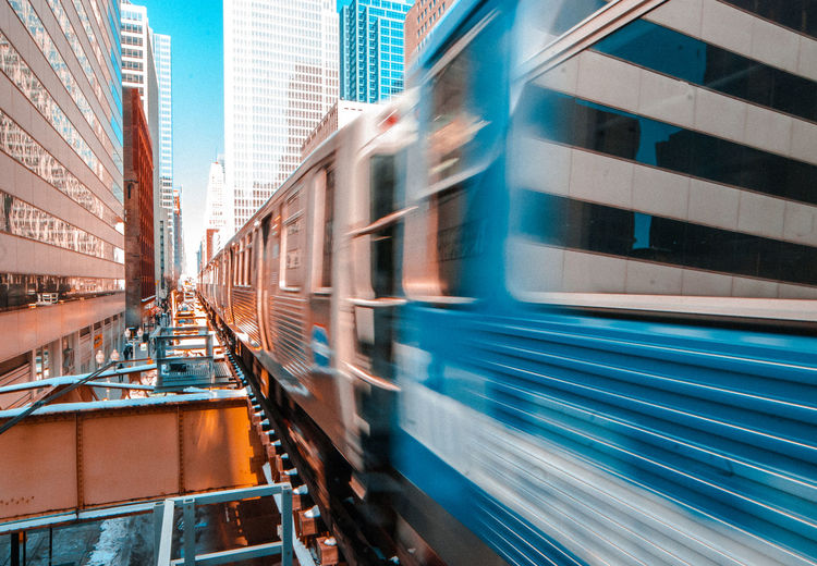 Train in motion in the city