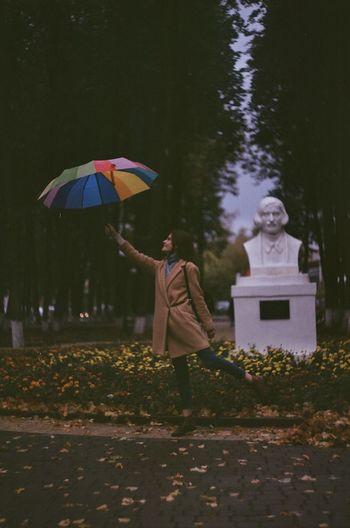 Man with umbrella standing on wet rainy day