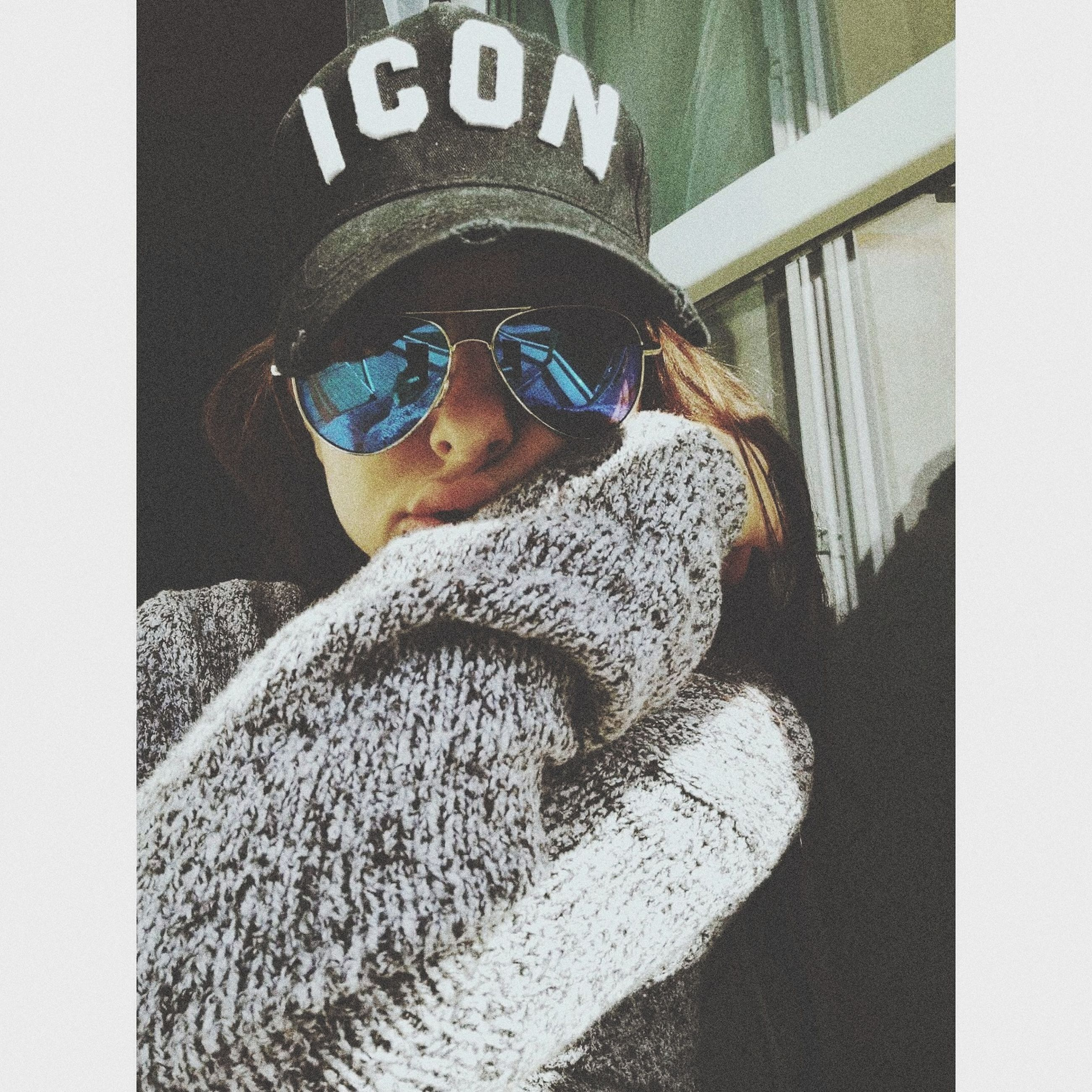 cap, indoors, real people, one person, day, warm clothing, close-up, people