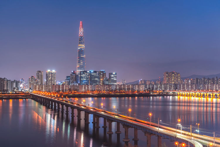 Lotte tower downtown skyline at night in seoul Korea. Seoul, Korea Architecture Building Building Exterior Built Structure City City Life Cityscape Downtown; Skyscraper; Background; Nature; Financial District  Illuminated Landscape Lotte Tower Modern Night Night; City; View; Skyline; Landmark; Cityscape; World; Travel; No People Office Building Exterior Outdoors Reflection Sky Skyscraper Travel Destinations Urban Skyline Water