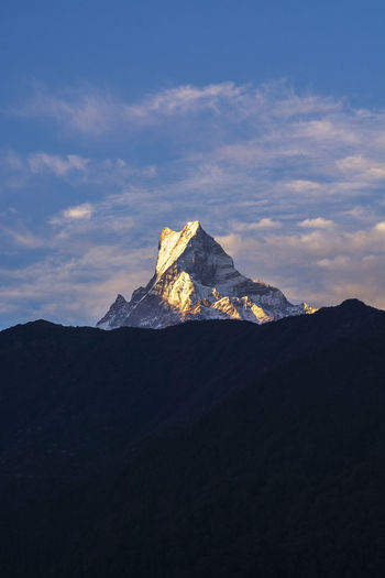 Fishtail Mountain Peak, Nepal Mountain Sky Scenics - Nature Beauty In Nature Tranquil Scene Tranquility Cloud - Sky Non-urban Scene Mountain Peak Mountain Range Nature Environment No People Idyllic Landscape Physical Geography Outdoors Remote Land Majestic Formation Snowcapped Mountain Fishtail Mountain Nepal