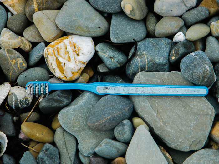 Toothbrush on pebbles