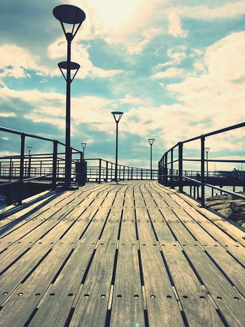 Street Light Wooden Art Beauty Clouds Shapes Lines Sky Cloud - Sky Street Light Water Street Nature Pier Sea Transportation Footpath Built Structure Day Direction Railing Lighting Equipment Architecture The Way Forward No People Outdoors Diminishing Perspective