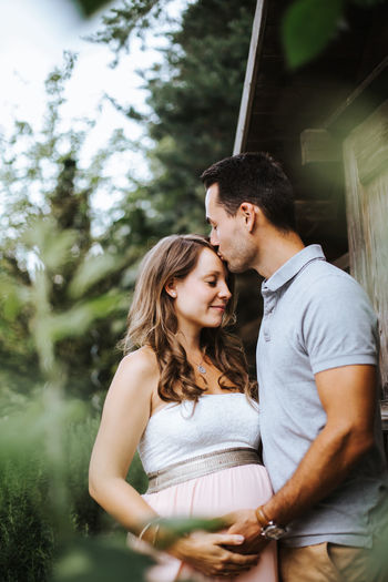 pregnant woman and her husband sharing some joyful moments outdoors Couple Love Pregnant Woman Relationship Relaxing Adult Bonding Bonding Time Couple - Relationship Emotion Heterosexual Couple Love Marriage  Men Positive Emotion Pregnancy Pregnant Real People Together Togetherness Two People Women Young Adult Young Men Young Women