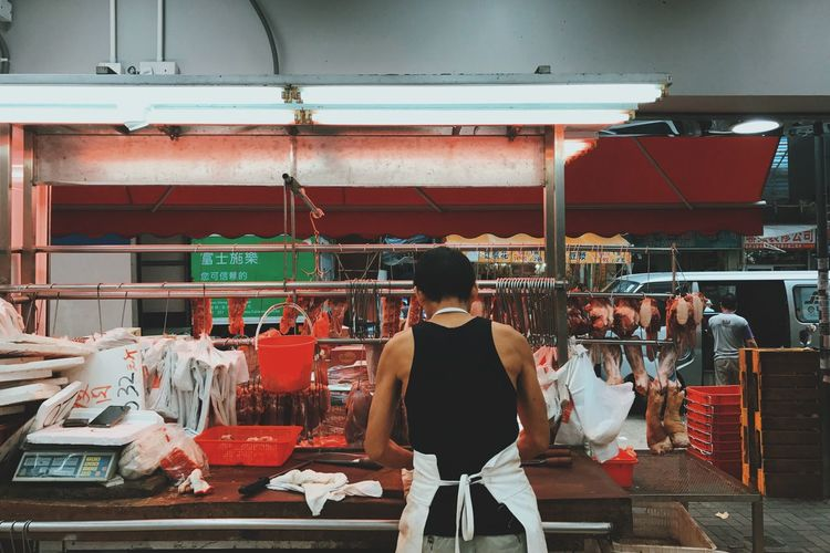 Retail  Men Food And Drink Casual Clothing Rear View Standing Selling Market Stall Choice Leisure Activity Indoors  Store Buying Small Business Customer  Food Collection Shopping Variation In Front Of The Street Photographer - 2017 EyeEm Awards