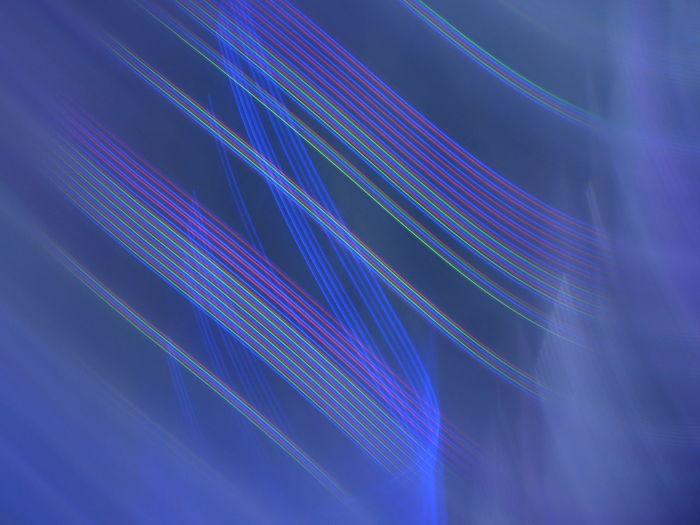 Full frame shot of illuminated light painting against black background